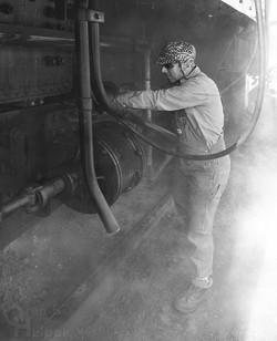Jerry Dziedzic cleaning ashpan
