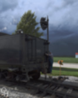 Strasburg Rail Road #90 and Earl Knoob under storm clouds at the Pennsy signal on East Strasburg station runaround