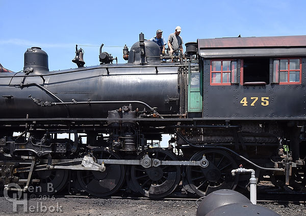 Strasburg Rail Road hostlers Dave Lotfi and Ross Gochenaur atop #475, diagnosing valve leak