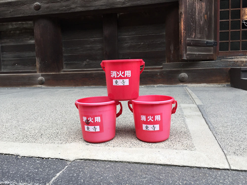 Plastic buckets for extinguishing fire at Toji temple