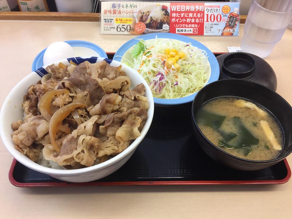 Beef bowl, miso soup, raw egg and mix salad at Matsuya