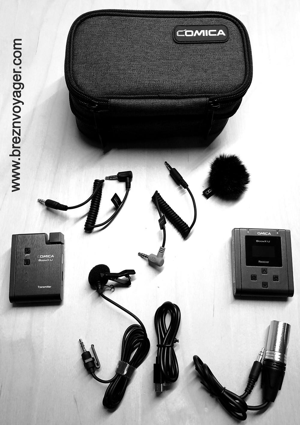 Neben dem Sender und dem Empfänger sind diverse Adapterkabel, Lavalier Mikrofon und Tasche im Lieferumfang