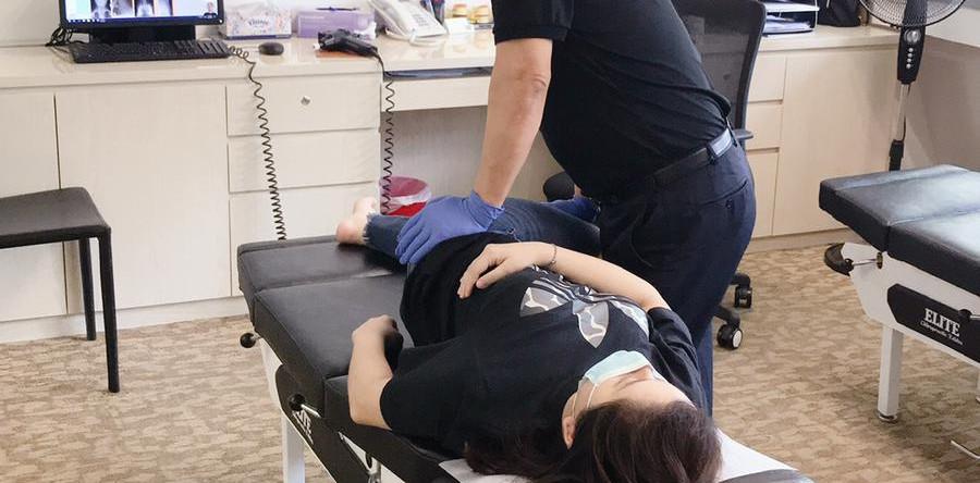 Dr John adjusting a patient