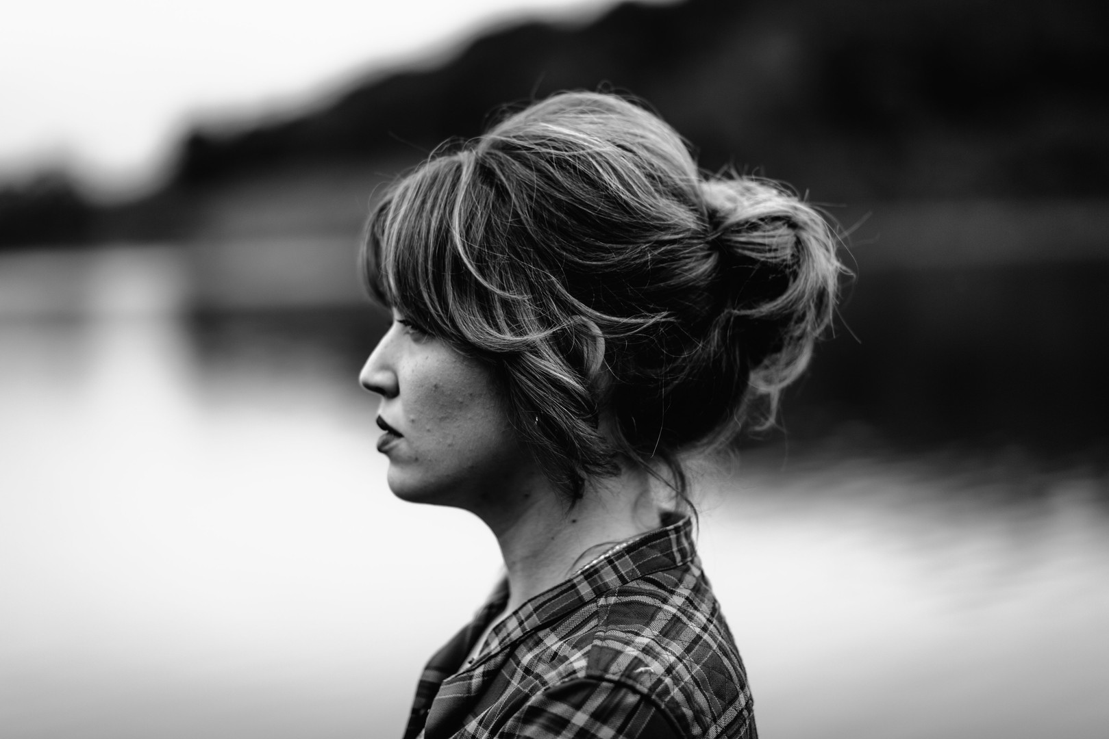 Side profile of woman with Indigo Collective's flawless up-do hairstyle with bangs near Clinton, NJ