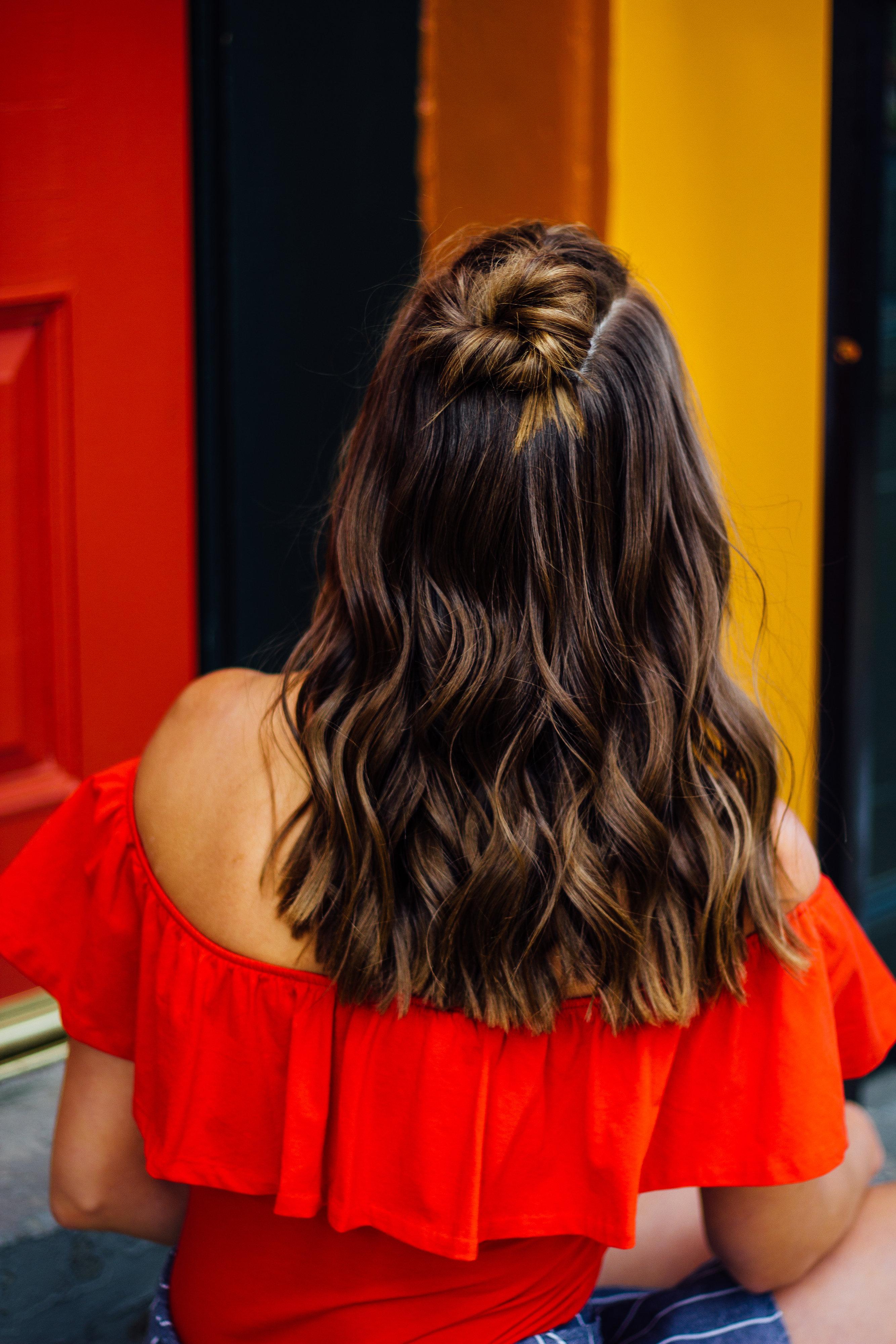 Woman with hair cut & style on dark brown hair by hair stylist at Indigo Collective near Clinton, NJ