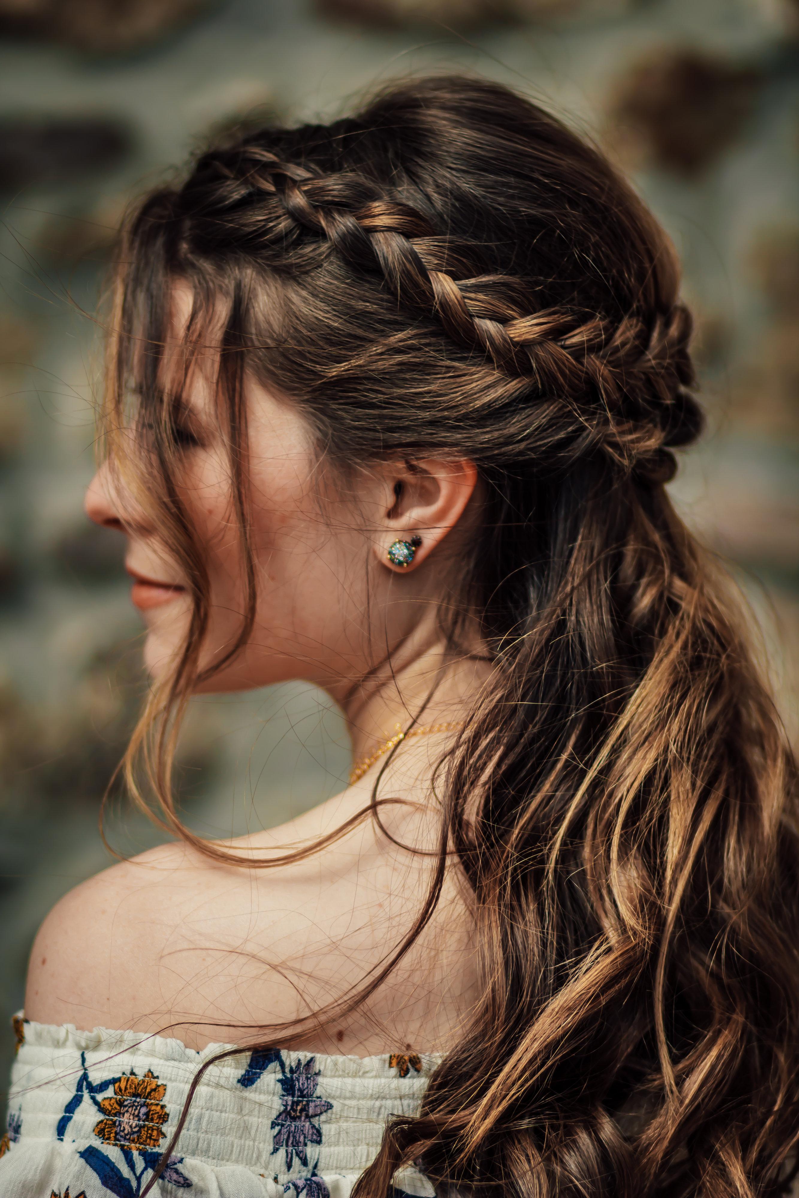 Elegantly braided crown on long brown hair by Indigo Collective hair stylist team near Clinton