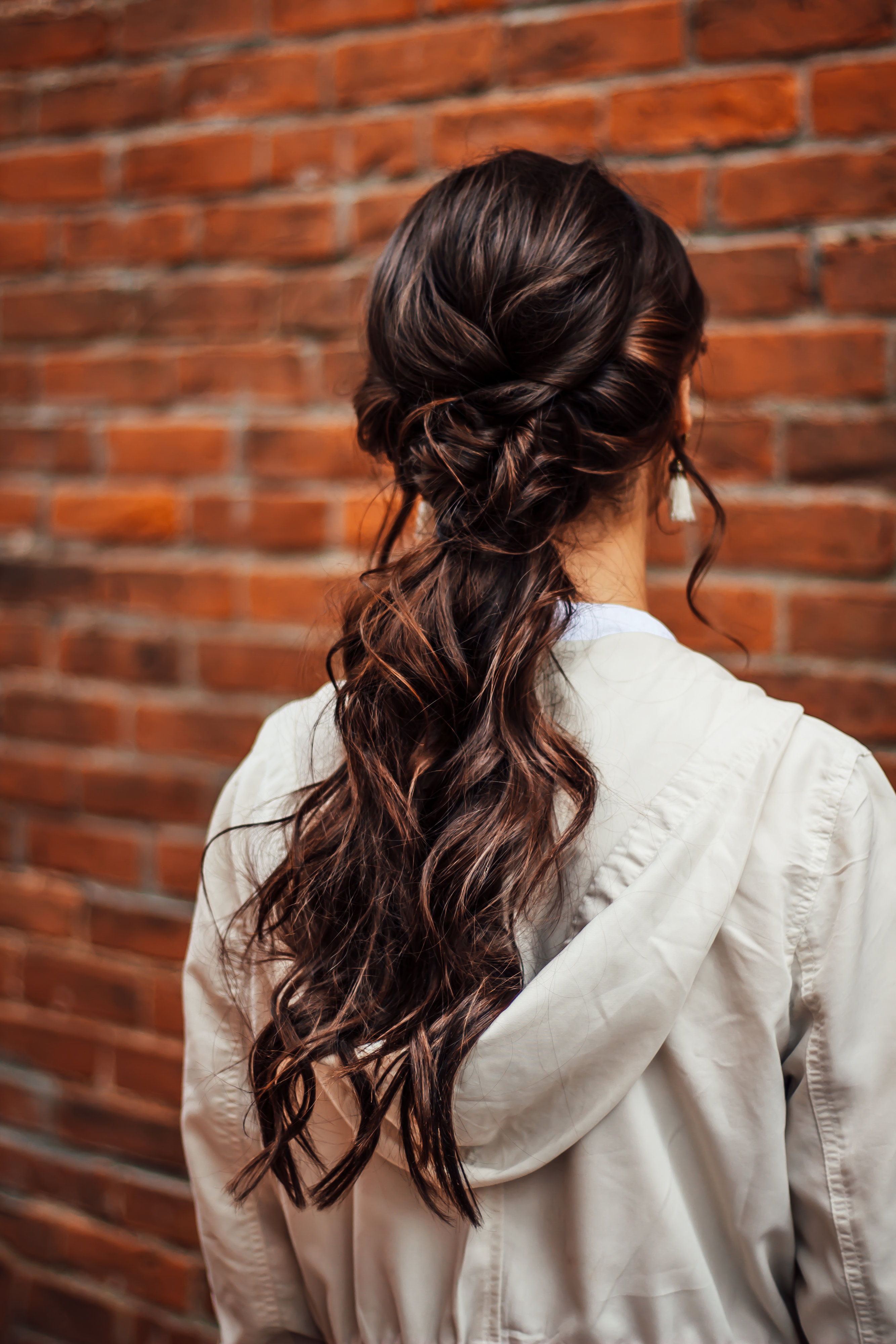 Woman with complex braiding hairstyle on long brown hair at Indigo Collective at Hunterdon, NJ