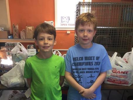 2 Small Boys + One Average Yard Sale = One Large Donation