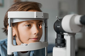 Close up shot of boy checking vision wit