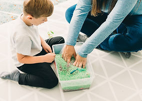 Child playing with sensory bin