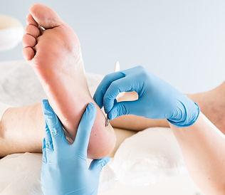 Podiatrist treating toenail fungus.jpg P