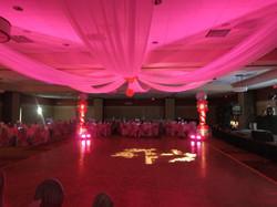 Pink uplighting on Ceiling Drapery