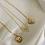 Thumbnail: Moon & Sun necklace
