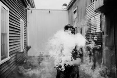 coloured smoke black and white photo