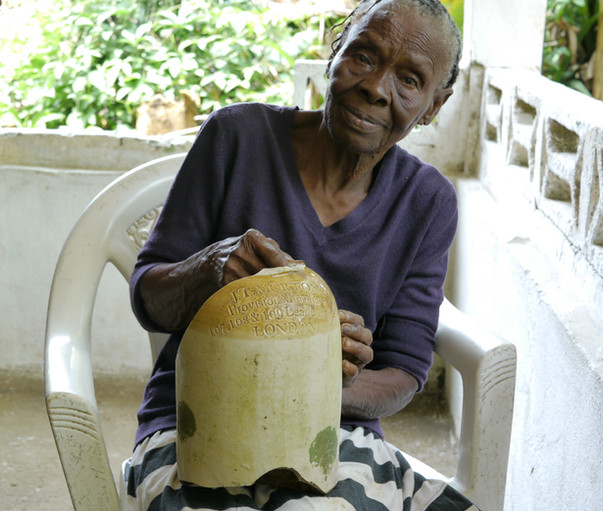 Gran with a recovered stoneware jar.
