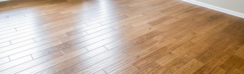A shiny, polished hardwood floor in a ne