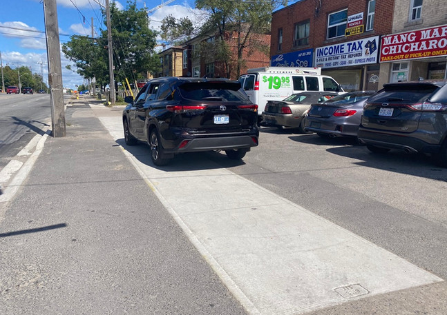 car parked on sidewalk.jpeg