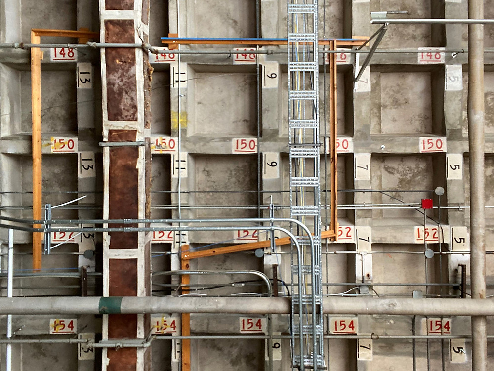 The ceiling at the No. 1 Supply Depot, showing tracks for the internal train that moved materials around the building and coordinates to locate them