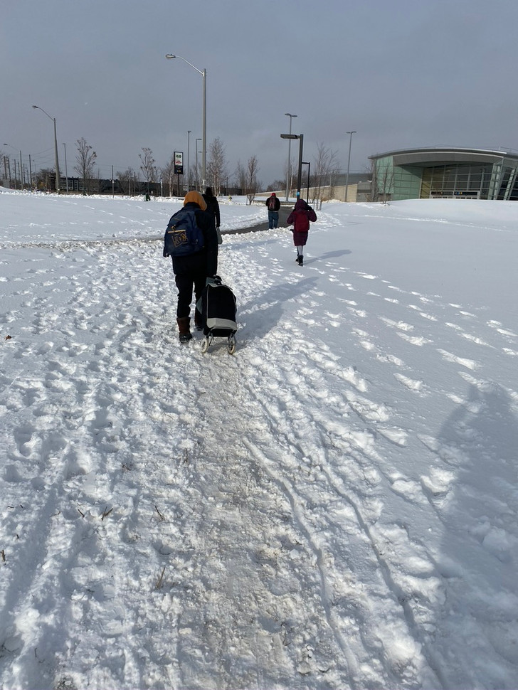 Back in the winter we saw people navigating snowy, icy, and unsafe conditions.  Here, people make informal routes through the snow.