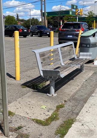 empty bench near traffic.jpeg