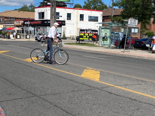 Without proper cycling infrastructure, cyclists navigate wide arterials, which can be risky.