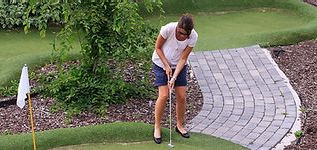 young posh lady playing golf