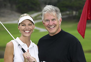 happy healthy couple in their 50s smiling