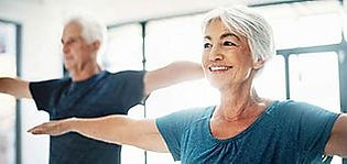 50 somethings at the gym light exercise.