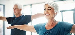 50 somethings at the gym light exercise