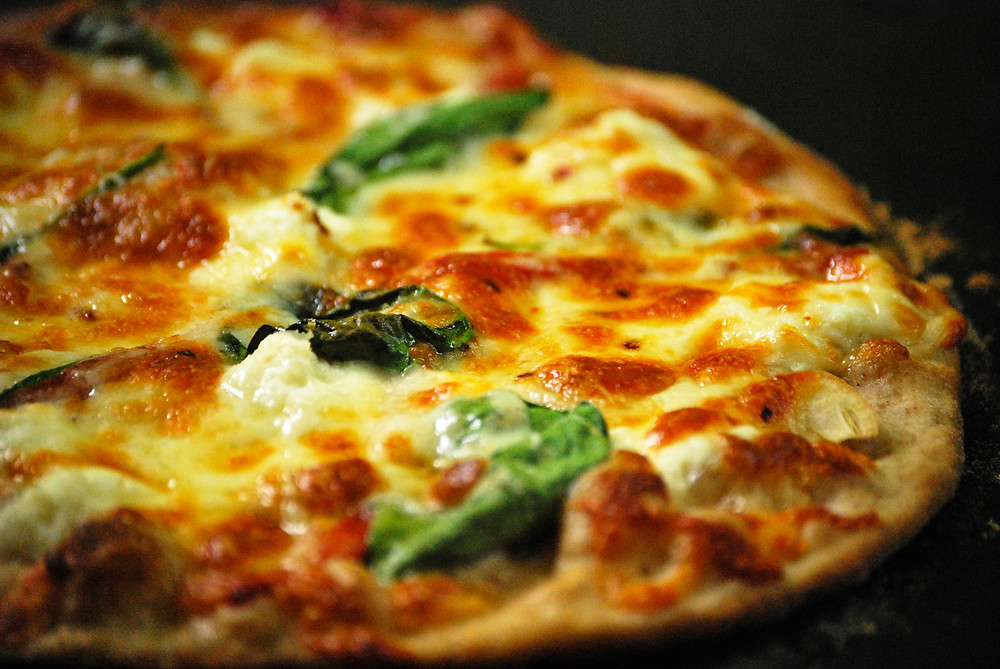 hand made delicious oven baked  pizzas
