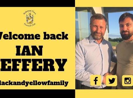 Ian Jeffery signs
