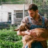 Farmer Holding Goat