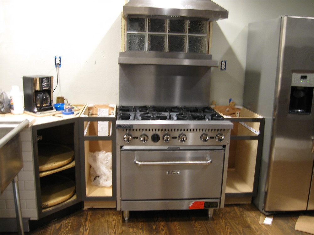 I chose true commercial grade appliances.  Not just a Viking stove for the kitchen, but a Black Diamond.  It has its advantages and yet problems.  With real chef grade appliances, sometimes you need to be aware of insurance limitations and some of the everyday conveniences.  For insurance purposes and safety, the pilot lights need to be lit manually.  I don't mind, as it gives me peace of mind and a true chefs experience.  I was also able to procure the equivalent of a $7000 stove for far less than a more popular name brand. This six burner beast was purchased for under $1500 with a little luck and good timing.