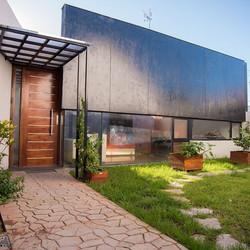Casa PH-M, Proyecto y construcción