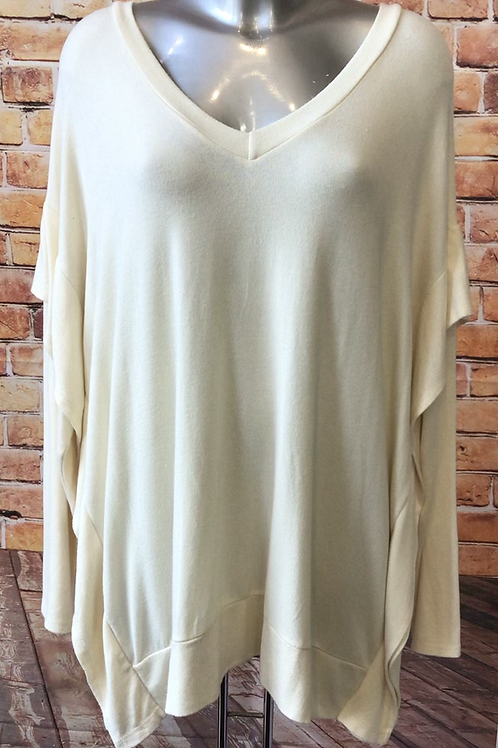 V neck cream jumper with quirky side detail