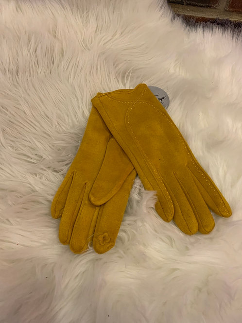 Mustard super soft gloves with stitching detail.