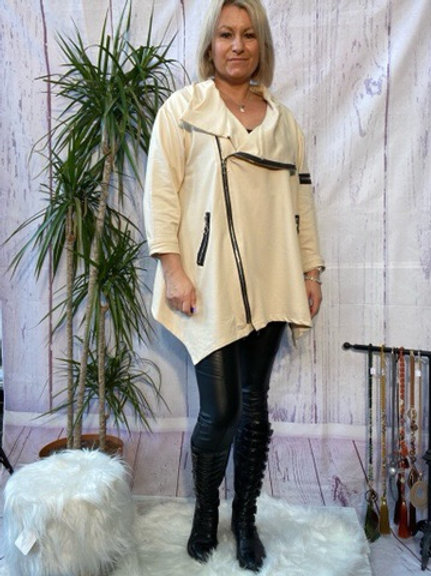 Cream quirky zip top, fitting up to a size 24.   9111