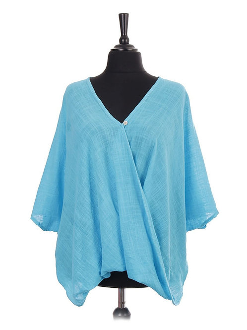 Turquoise plain crossover top, fitting sizes 10-24