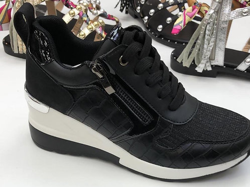 Black wedge trainers