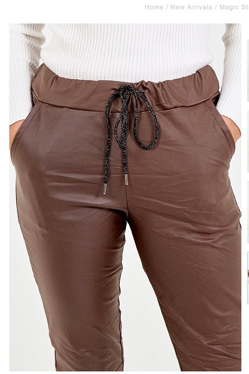 Brown leather look trousers fitting up to a size 18