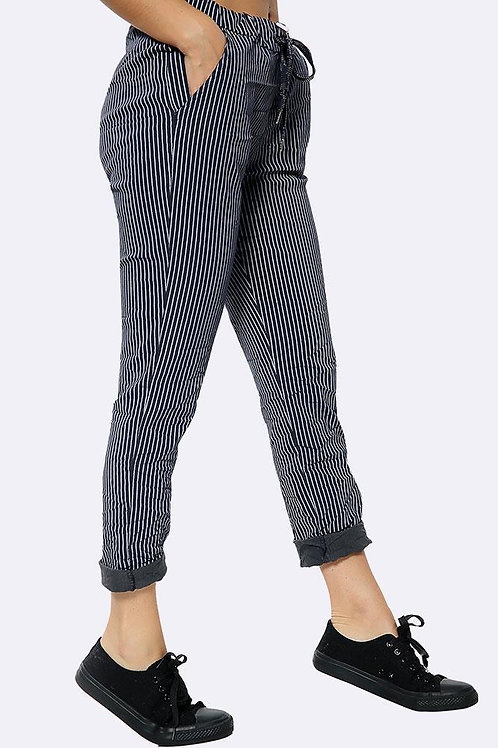 Black pinstripe magic joggers, fitting from a size 10-20.   0408