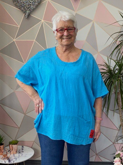 Turquoise red label cotton top, fitting up to a size 22