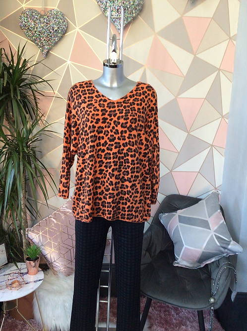 Orange leopard print top, fitting sizes 10-16.      1779