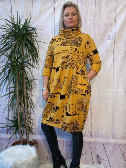 Mustard monet tunic, fitting up to a size 16.   6565