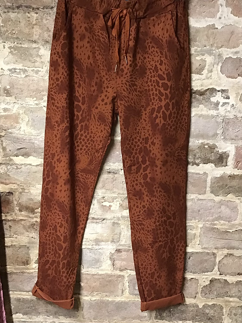Rust snake print magic joggers, fitting up to a size 20.   0901
