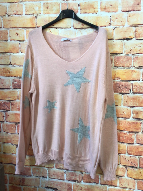 Pale pink knitted star pattern jumper, fitting sizes 8-12