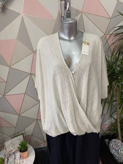 Beige plain crossover top, fitting sizes 10-24