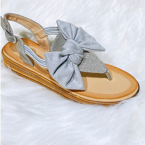 Silver bow detail toe post sandals