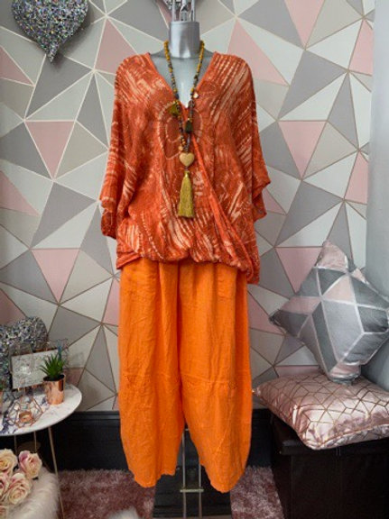 Burnt orange fossil print crossover top, fitting sizes 10-24
