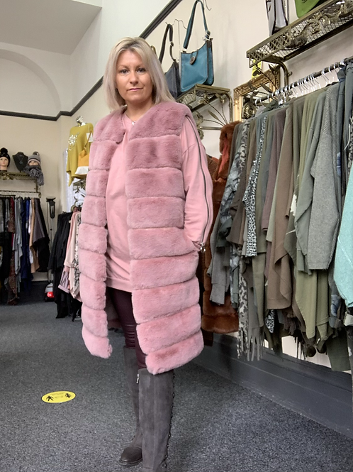 Pink knee length  faux fur hooded gilet fitting up to a size 16